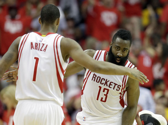 "<div class=""meta image-caption""><div class=""origin-logo origin-image ap""><span>AP</span></div><span class=""caption-text"">Houston Rockets' James Harden, right, is congratulated by teammate Trevor Ariza after stealing the ball and taking it to the basket during the first half in Game 4. (David J. Phillip)</span></div>"