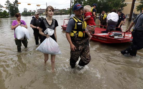 <div class='meta'><div class='origin-logo' data-origin='AP'></div><span class='caption-text' data-credit='AP Photo/David J. Phillip'>Residents are evacuated from their flooded apartment complex Tuesday, April 19, 2016, in Houston</span></div>