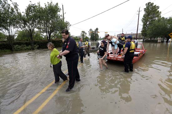 <div class='meta'><div class='origin-logo' data-origin='AP'></div><span class='caption-text' data-credit='AP Photo/David J. Phillip'>Residents are helped off rescue boats after being evacuated from their flooded apartment complex Tuesday, April 19, 2016</span></div>