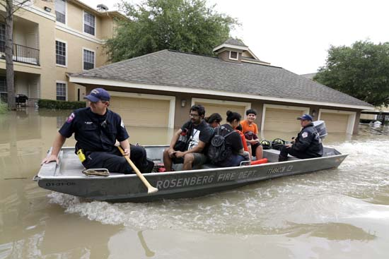 <div class='meta'><div class='origin-logo' data-origin='AP'></div><span class='caption-text' data-credit='AP Photo/David J. Phillip'>Residents are evacuated from their flooded apartment complex Tuesday, April 19, 2016.</span></div>