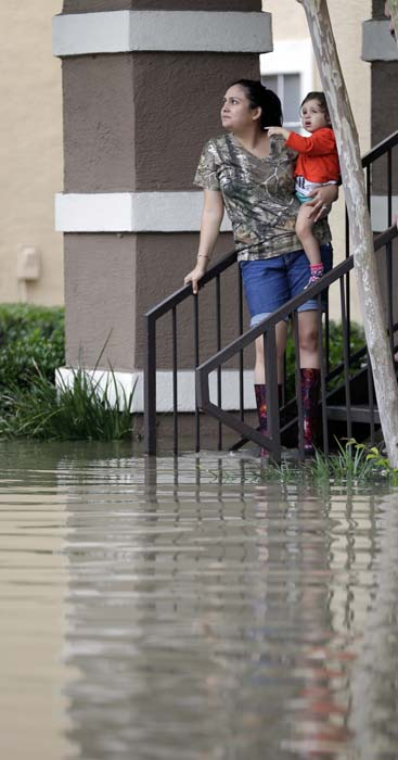 <div class='meta'><div class='origin-logo' data-origin='AP'></div><span class='caption-text' data-credit='AP Photo/David J. Phillip'>Residents wait to be evacuated from their flooded apartment complex Tuesday, April 19, 2016, in Houston</span></div>