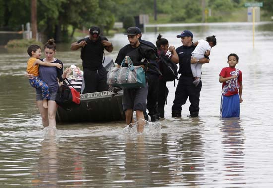 <div class='meta'><div class='origin-logo' data-origin='AP'></div><span class='caption-text' data-credit='AP Photo/David J. Phillip'>Residents walk through floodwaters after being evacuated from their flooded apartment complex</span></div>