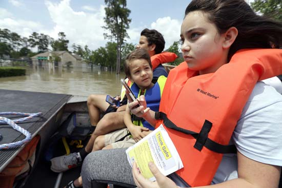 <div class='meta'><div class='origin-logo' data-origin='KTRK'></div><span class='caption-text' data-credit='AP Photo/David J. Phillip'>Phillip Holden, center, looks to his sister Brianna as they are evacuated from their flooded neighborhood</span></div>
