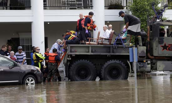 <div class='meta'><div class='origin-logo' data-origin='AP'></div><span class='caption-text' data-credit='AP Photo/David J. Phillip'>Residents are evacuated from a retirement and assisted living complex as floodwaters rise</span></div>