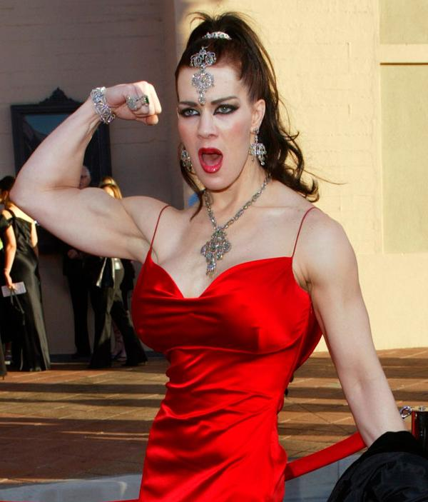 <div class='meta'><div class='origin-logo' data-origin='AP'></div><span class='caption-text' data-credit='AP Photo/Kevork Djansezian'>Joanie Laurer, former pro wrestler known as Chyna, flexes her bicep as she arrives at the 31st annual American Music Awards, Sunday, Nov. 16, 2003, in Los Angeles.</span></div>