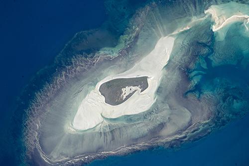 "<div class=""meta image-caption""><div class=""origin-logo origin-image none""><span>none</span></div><span class=""caption-text"">A tiny island off Australia's north coast with many concentric zones around it. (NASA)</span></div>"