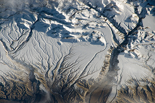 <div class='meta'><div class='origin-logo' data-origin='none'></div><span class='caption-text' data-credit='NASA'>The Himalaya range, near the China-India border, where peaks cast strong evening shadows on the snow.</span></div>