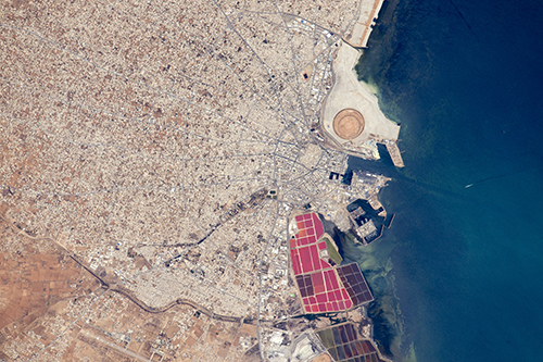 <div class='meta'><div class='origin-logo' data-origin='none'></div><span class='caption-text' data-credit='NASA'>The radiating street pattern of Tunisia's second city and major port of Sfax that also hosts Tunisia's largest fishing fleet.</span></div>
