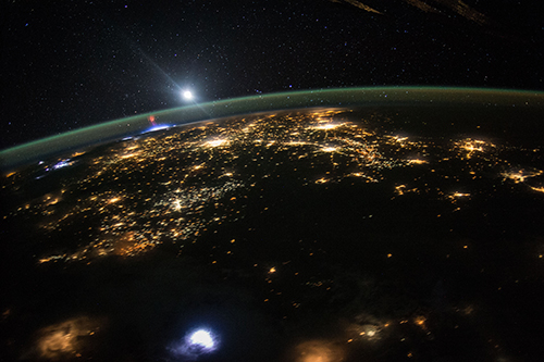 "<div class=""meta image-caption""><div class=""origin-logo origin-image none""><span>none</span></div><span class=""caption-text"">A red sprite above the white light of an active thunderstorm over northwest Mexico. (NASA)</span></div>"