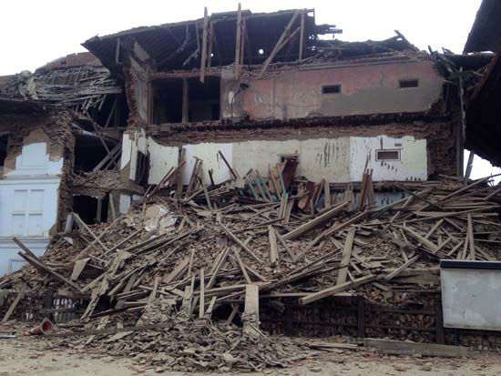 <div class='meta'><div class='origin-logo' data-origin='none'></div><span class='caption-text' data-credit='AP Photo/ Niranjan Shrestha'>A building stands damaged after an earthquake in Kathmandu, Nepal</span></div>
