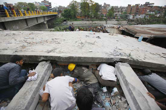 <div class='meta'><div class='origin-logo' data-origin='none'></div><span class='caption-text' data-credit='AP Photo/ Niranjan Shrestha'>Rescuers look for victims under a building that collapsed after an earthquake in Kathmandu, Nepal</span></div>