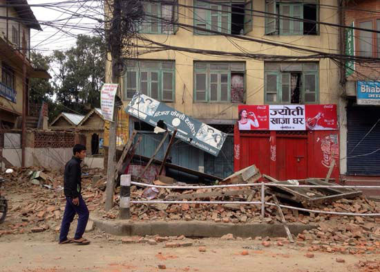 <div class='meta'><div class='origin-logo' data-origin='none'></div><span class='caption-text' data-credit='AP Photo/ Niranjan Shrestha'>An  man walks past damage caused by an earthquake in Kathmandu, Nepal</span></div>