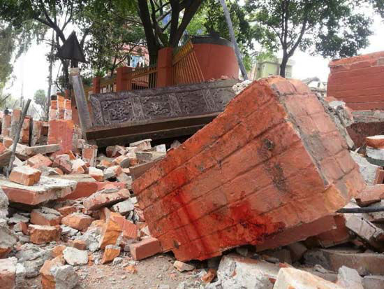 <div class='meta'><div class='origin-logo' data-origin='none'></div><span class='caption-text' data-credit='AP Photo/ Zhou Shengping'>In this photo released by China's Xinhua News Agency, a collapsed building is seen in Nepal's capital Kathmandu</span></div>