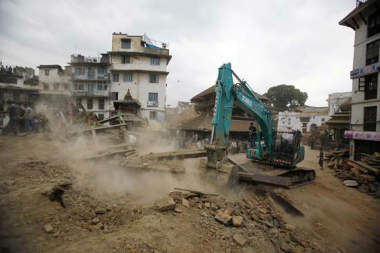 <div class='meta'><div class='origin-logo' data-origin='none'></div><span class='caption-text' data-credit='AP Photo/ Niranjan Shrestha'>A crane removes debris from the site of a building that collapsed in an earthquake in Kathmandu, Nepal</span></div>