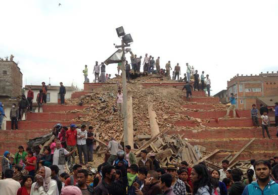 <div class='meta'><div class='origin-logo' data-origin='none'></div><span class='caption-text' data-credit='AP Photo/ Niranjan Shrestha'>People stand around damage caused by an earthquake at Durbar Square in Kathmandu, Nepal</span></div>