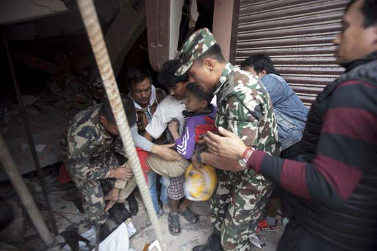<div class='meta'><div class='origin-logo' data-origin='none'></div><span class='caption-text' data-credit='AP Photo/ Niranjan Shrestha'>Volunteers carry an injured boy after rescuing him from the debris of a building that was damaged in an earthquake in Kathmandu, Nepal</span></div>