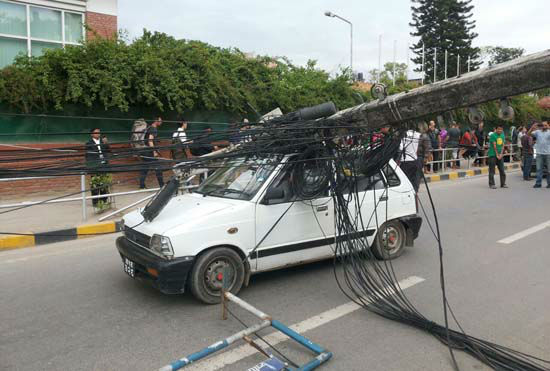 <div class='meta'><div class='origin-logo' data-origin='none'></div><span class='caption-text' data-credit='AP Photo/ Tashi Sherpa'>A car stands under the weight of an electric pole after it collapsed following an earthquake in Kathmandu, Nepal</span></div>