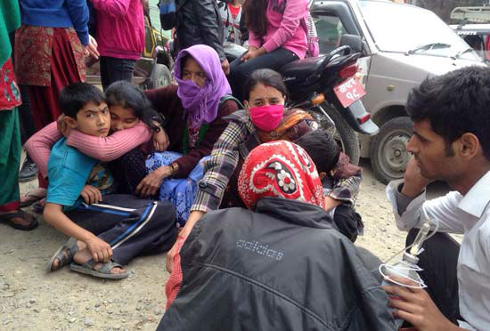 <div class='meta'><div class='origin-logo' data-origin='none'></div><span class='caption-text' data-credit='AP Photo/ Niranjan Shrestha'>Nepalese people huddle together outside the Medicare Hospital in Kathmandu, Nepal</span></div>
