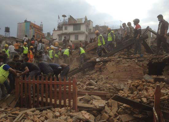 <div class='meta'><div class='origin-logo' data-origin='none'></div><span class='caption-text' data-credit='AP Photo/ Niranjan Shrestha'>Rescuers clear the debris at Durbar Sqaure after an earthquake in Kathmandu, Nepal, Saturday, April 25, 2015</span></div>