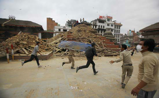 <div class='meta'><div class='origin-logo' data-origin='none'></div><span class='caption-text' data-credit='AP Photo/ Niranjan Shrestha'>Volunteers run with a stretcher to carry a dead body recovered from the debris of a building that collapsed</span></div>