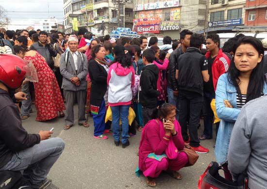 <div class='meta'><div class='origin-logo' data-origin='none'></div><span class='caption-text' data-credit='AP Photo/ Niranjan Shrestha'>A group of people gather outdoors on a street as an earthquake hits Kathmandu city, Nepal</span></div>