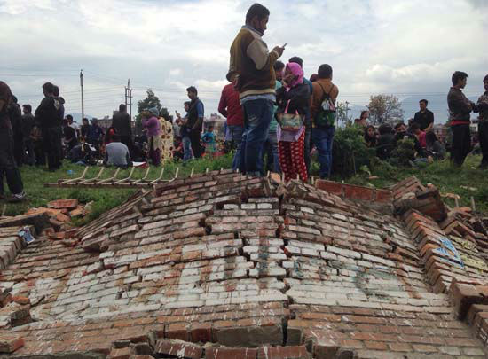 <div class='meta'><div class='origin-logo' data-origin='none'></div><span class='caption-text' data-credit='AP Photo/ Niranjan Shrestha'>A group of people gather outdoors as an earthquake hits Kathmandu city, Nepal, Saturday, April 25, 2015</span></div>