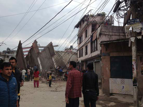 <div class='meta'><div class='origin-logo' data-origin='none'></div><span class='caption-text' data-credit='AP Photo/ Guna Raj Luitel'>In this photo provided by Guna Raj Luitel, people walk next to ruble after an earthquake in Kathmandu, Nepal</span></div>