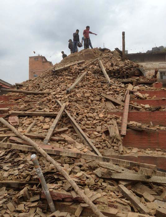 <div class='meta'><div class='origin-logo' data-origin='none'></div><span class='caption-text' data-credit='AP Photo/ Niranjan Shrestha'>Volunteers help with rescue work at the site of a building that collapsed after an earthquake in Kathmandu, Nepal</span></div>