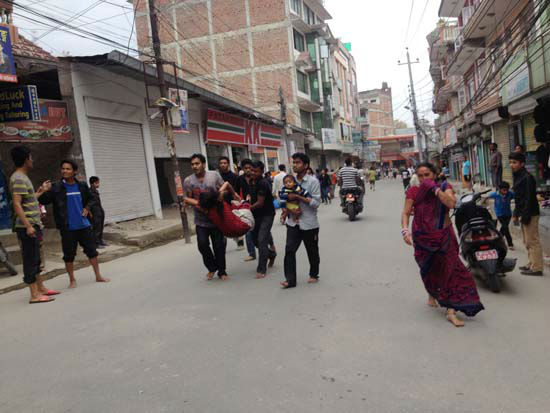 <div class='meta'><div class='origin-logo' data-origin='none'></div><span class='caption-text' data-credit='AP Photo/ Guna Raj Luitel'>In this photo provided by Guna Raj Luitel, an injured woman is carried just after an earthquake in Kathmandu, Nepal</span></div>