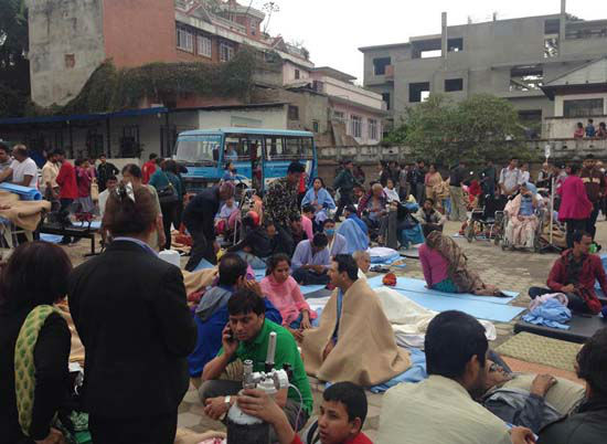 <div class='meta'><div class='origin-logo' data-origin='none'></div><span class='caption-text' data-credit='AP Photo/ Binaj Gurubacharya'>Patients wait at the parking lot of Norvic International Hospital after the earthquake</span></div>