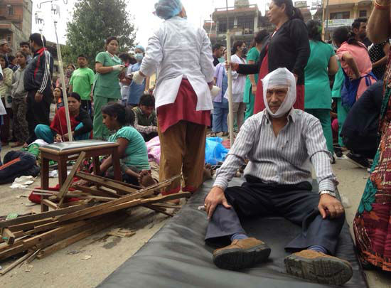 <div class='meta'><div class='origin-logo' data-origin='none'></div><span class='caption-text' data-credit='AP Photo/ Niranjan Shrestha'>Injured people receive treatment outside the Medicare Hospital in Kathmandu, Nepal</span></div>