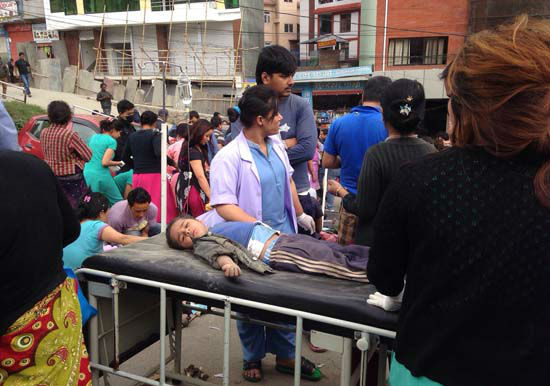 <div class='meta'><div class='origin-logo' data-origin='none'></div><span class='caption-text' data-credit='AP Photo/ Niranjan Shrestha'>An injured child receives treatment outside Medicare Hospital in Kathmandu, Nepal</span></div>
