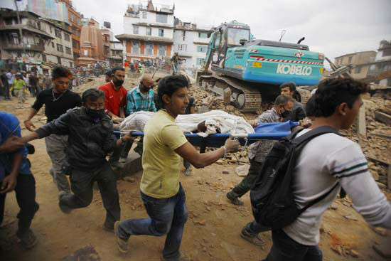 <div class='meta'><div class='origin-logo' data-origin='none'></div><span class='caption-text' data-credit='AP Photo/Niranjan Shrestha'>Volunteers carry the body of a victim on a stretcher, recovered from the debris of a building that collapsed</span></div>