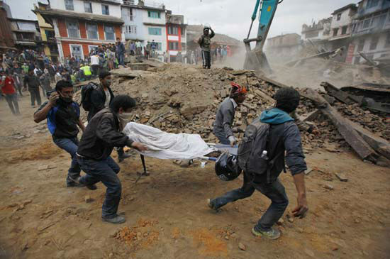 <div class='meta'><div class='origin-logo' data-origin='none'></div><span class='caption-text' data-credit='AP Photo/ Niranjan Shrestha'>Volunteers carry the body of a victim on a stretcher, recovered from the debris of a building that collapsed</span></div>