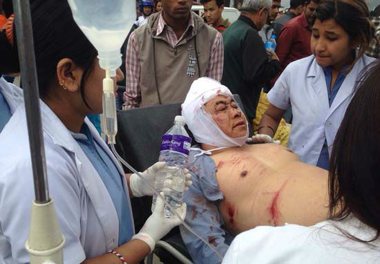 <div class='meta'><div class='origin-logo' data-origin='none'></div><span class='caption-text' data-credit='AP Photo/ Niranjan Shrestha'>An injured person receives treatment outside the Medicare Hospital in Kathmandu, Nepal</span></div>