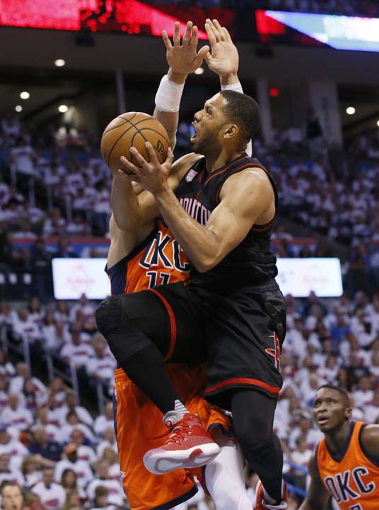 <div class='meta'><div class='origin-logo' data-origin='AP'></div><span class='caption-text' data-credit='AP'>Houston Rockets guard Eric Gordon, right, shoots as Oklahoma City Thunder center Steven Adams defends during the first half of Game 4. (AP Photo/Sue Ogrocki)</span></div>