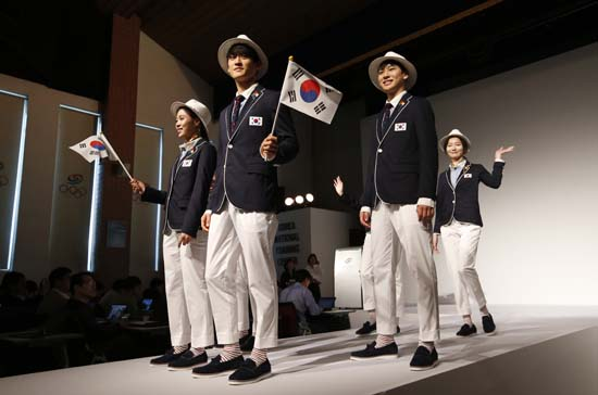 <div class='meta'><div class='origin-logo' data-origin='AP'></div><span class='caption-text' data-credit='AP Photo/Lee Jin-man'>South Korean Olympic athletes and models present the South Korean Olympic team uniforms for the opening and closing ceremonies of the 2016 Rio de Janeiro Olympic Games</span></div>