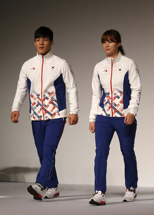 <div class='meta'><div class='origin-logo' data-origin='AP'></div><span class='caption-text' data-credit='AP Photo/Lee Jin-man'>South Korean Olympic wrestling athlete Kim Hyeon-woo, left, and handball athlete Kim On-a, right, present the South Korean Olympic team uniforms</span></div>