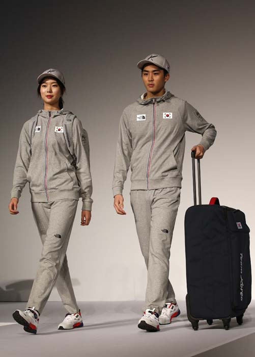 <div class='meta'><div class='origin-logo' data-origin='AP'></div><span class='caption-text' data-credit='AP Photo/Lee Jin-man'>South Korean models present the South Korean Olympic team uniforms for the 2016 Rio de Janeiro Olympic Games</span></div>
