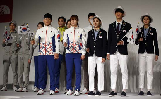 <div class='meta'><div class='origin-logo' data-origin='AP'></div><span class='caption-text' data-credit='AP Photo/Lee Jin-man'>South Korean Olympic athletes and models present the South Korean Olympic team uniforms for the 2016 Rio de Janeiro Olympic Games</span></div>