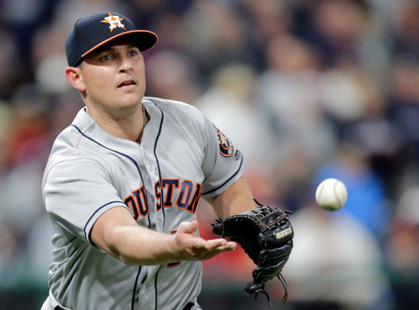 "<div class=""meta image-caption""><div class=""origin-logo origin-image none""><span>none</span></div><span class=""caption-text"">Houston Astros relief pitcher Will Harris tosses the ball to first bases to get Cleveland Indians' Lonnie Chisenhall out in the ninth inning of Thursday's game. (AP Photo/Tony Dejak)</span></div>"
