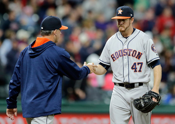 "<div class=""meta image-caption""><div class=""origin-logo origin-image none""><span>none</span></div><span class=""caption-text"">Houston Astros relief pitcher Chris Devenski, right, hands the ball off to manager A.J. Hinch during the seventh inning of the team's baseball game against the Cleveland Indians. (AP Photo/Tony Dejak)</span></div>"