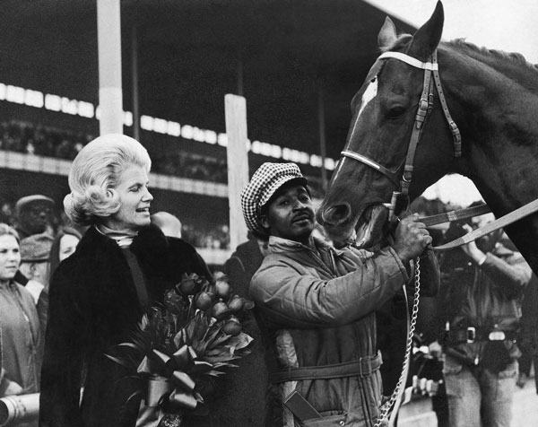 <div class='meta'><div class='origin-logo' data-origin='none'></div><span class='caption-text' data-credit='AP Photo'>Penny Chenery, owner of Secretariat, and groom Eddie Sweat stand in paddock with Triple Crown winner Secretariat at New York's Aqueduct Raceway, Nov. 6, 1973.</span></div>