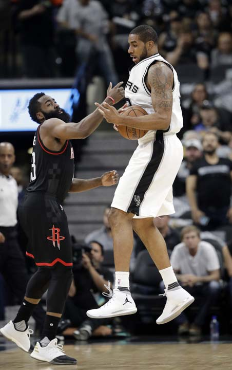 "<div class=""meta image-caption""><div class=""origin-logo origin-image ap""><span>AP</span></div><span class=""caption-text"">Houston Rockets' James Harden (13) causes San Antonio Spurs' LaMarcus Aldridge (12) to lose control of the ball during the first half in Game 5. (AP Photo/Eric Gay) (AP)</span></div>"