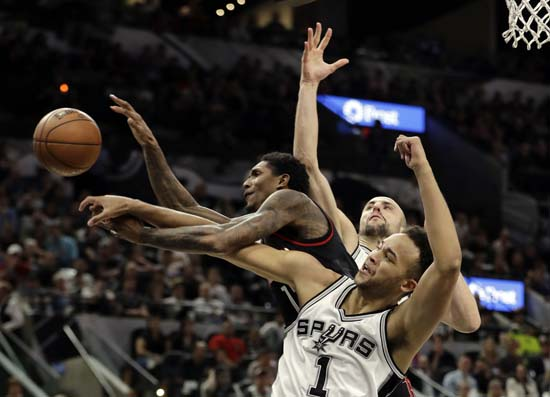 "<div class=""meta image-caption""><div class=""origin-logo origin-image ap""><span>AP</span></div><span class=""caption-text"">Houston Rockets guard Lou Williams (12) loses control of the ball on a shot attempt as San Antonio Spurs' Kyle Anderson (1) and Manu Ginobili, rear. (AP Photo/Eric Gay) (AP)</span></div>"