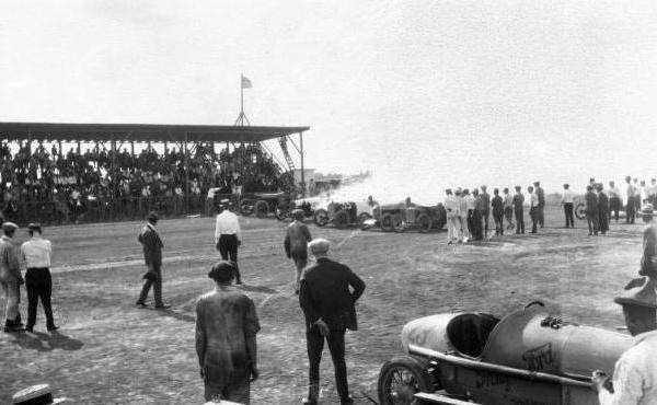 "<div class=""meta image-caption""><div class=""origin-logo origin-image ktrk""><span>KTRK</span></div><span class=""caption-text"">Men and racecars on the track at Bellaire, Texas with spectators at left  (Houston Public Library)</span></div>"
