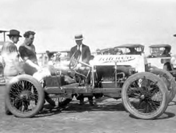 "<div class=""meta image-caption""><div class=""origin-logo origin-image ktrk""><span>KTRK</span></div><span class=""caption-text"">Three men looking at a racecar at Bellaire (Tex.) sometime during the 1920's. In background are open touring cars. White streak across middle of the picture caused by deteriorating (Houston Public Library)</span></div>"