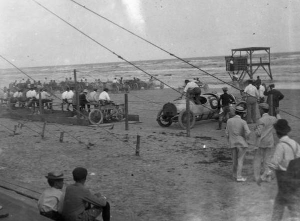 "<div class=""meta image-caption""><div class=""origin-logo origin-image ktrk""><span>KTRK</span></div><span class=""caption-text"">Racing cars and race fans on the track at Galveston, TX. Portion of photograph faded due to film deterioration. Gulf of Mexico visible in distance. During the 1920's. (Houston Public Library)</span></div>"
