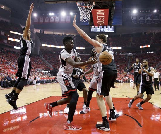 <div class='meta'><div class='origin-logo' data-origin='KTRK'></div><span class='caption-text' data-credit='AP'>Houston Rockets center Clint Capela passes the ball around San Antonio Spurs center Pau Gasol during the first half in Game 6. (AP Photo/Eric Christian Smith)</span></div>