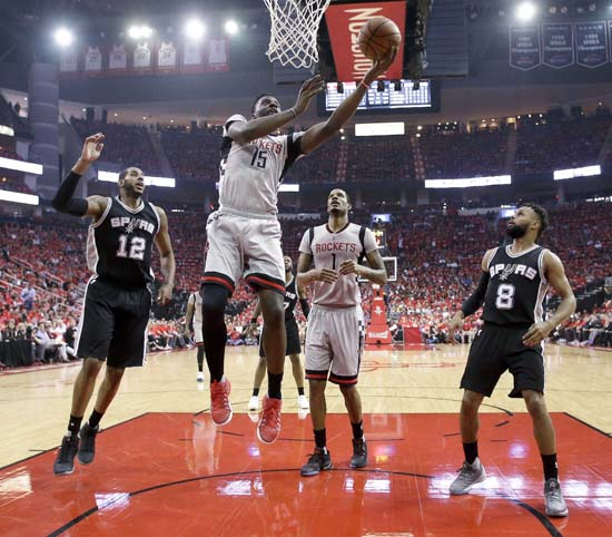 <div class='meta'><div class='origin-logo' data-origin='KTRK'></div><span class='caption-text' data-credit='AP'>Clint Capela (15) shoots as San Antonio Spurs forward LaMarcus Aldridge (12) and guard Patty Mills (8) watch during the first half in Game 6. (AP Photo/Eric Christian Smith)</span></div>